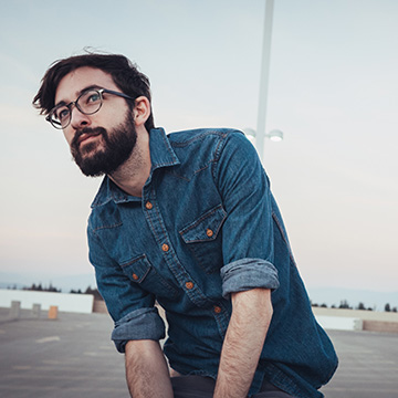 Hip young man with stylish eye glasses