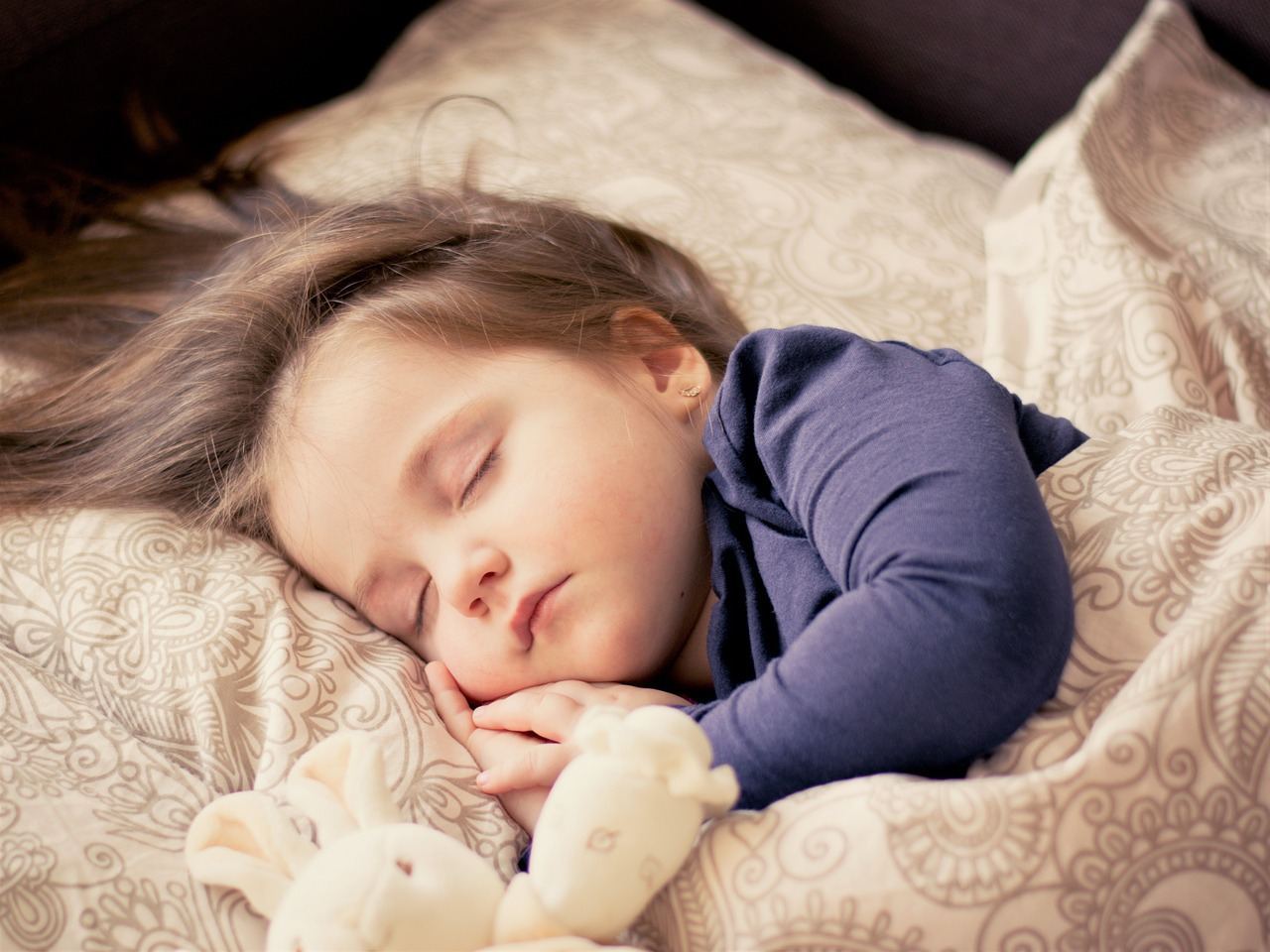 Infant sleeping in a bed