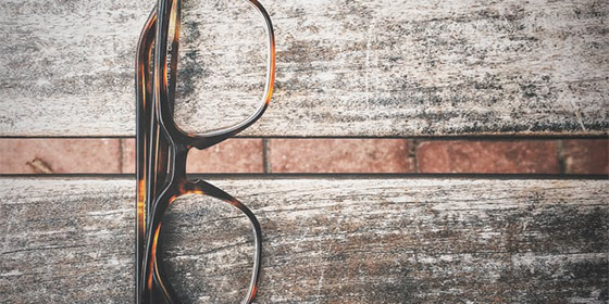Eye Glasses Sitting on Table